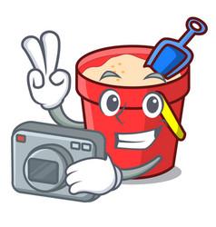 Photographer sand bucket mascot cartoon vector