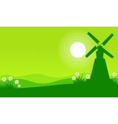 Silhouette of windmill on the hill at spring vector