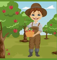 Farmer little boy picking apples vector