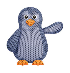 A funny knitted penguin toy who swings its wing vector