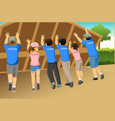 Group of volunteers building a house together vector