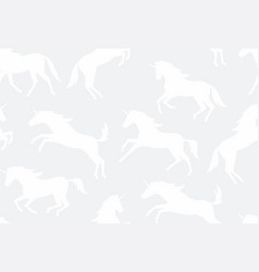 Seamless pattern with white unicorns silhouettes vector