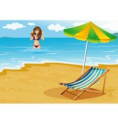 A beach with a lady in a purple bikini vector image