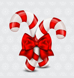 Christmas Candy Cane on a holiday background vector image vector image