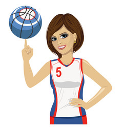 woman spinning basketball ball with her finger vector image