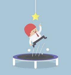 Businessman trying to catch the star by jumping on vector image vector image