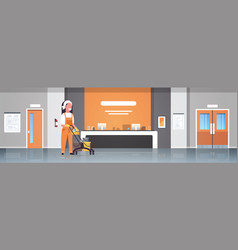 Woman janitor pushing trolley cart with supplies vector