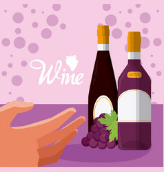 Hand grabbing wine bottles vector