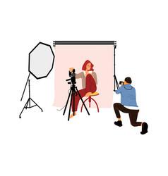 Photographer shooting model in studio photo vector