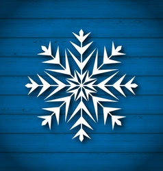Geometric snowflake on wooden background vector