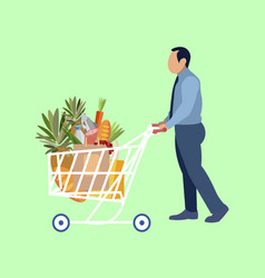 a man carries a supermarket trolley with food in vector image