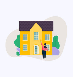 woman holding roller brush and painting a house vector image