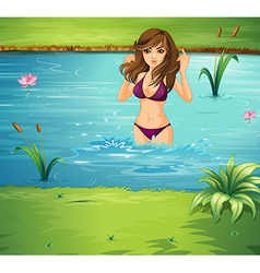 A girl swimming at the pond vector