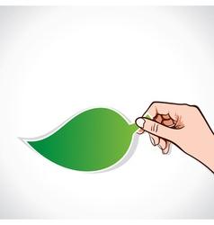 Green leaf sticker in hand vector