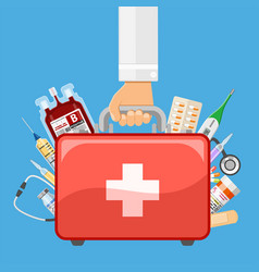 first aid kit in doctor hand vector image vector image