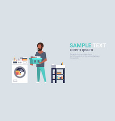 man with clothes basket standing near washing vector image