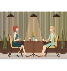 Two young women drinking coffee in the cafe vector image