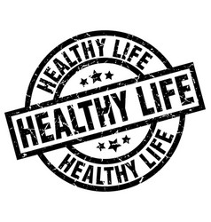 healthy life round grunge black stamp vector image