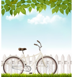 Bicycle in front of a white fence with green vector image