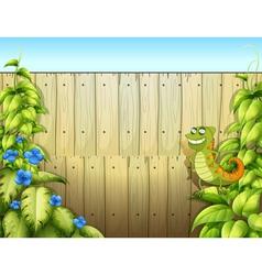 A lizard near the fence vector