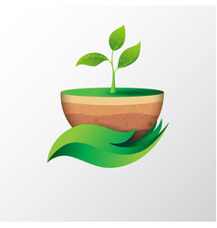Green leaf in hand shape holding sapling vector
