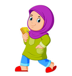 Moslem girl walking and carrying holy quran vector