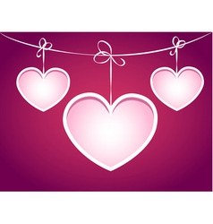 Three hearts hanging on a string vector