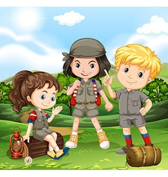 Children camping out in the park vector