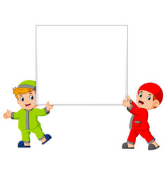 happy two moslem boy holding big blank sign vector image