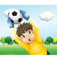 A boy playing soccer with a yellow uniform vector image