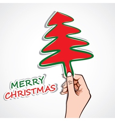 christmas tree in hand vector image vector image