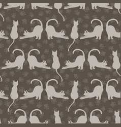 Brown and gray cute stretching cats pattern vector