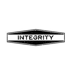 Grunge black integrity word hexagon rubber seal vector