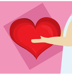 Heart being held by a man vector