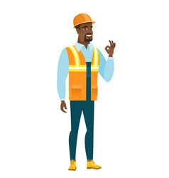 smiling builder showing ok sign vector image vector image
