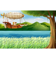 An airship near the river carrying two girls vector image