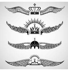 Wings with crowns emblems set vector