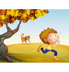 A boy running with a tiger at his back vector