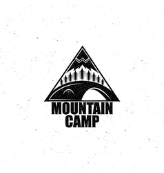 Black emblem with the wood tent and the mountain vector image vector image
