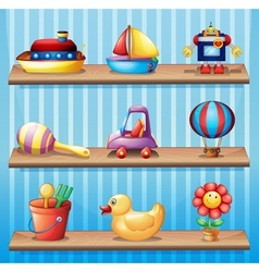 Three wooden shelves with different toys vector image