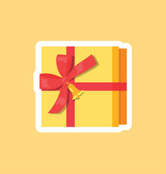 box decorated by red ribbon with bow golden bell vector image