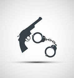 Gun and handcuffs vector