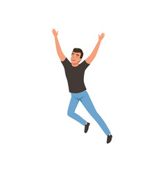Joyful guy in jumping action with hands up young vector
