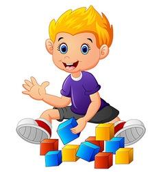 little boy play bricks vector image