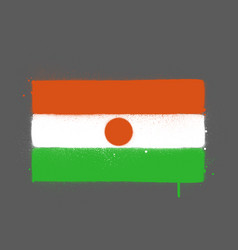 Graffti niger flag sprayed over grey vector