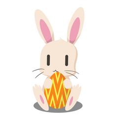rabbit holding easter egg vector image