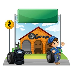 A boy standing beside a wheel outside the garage vector image