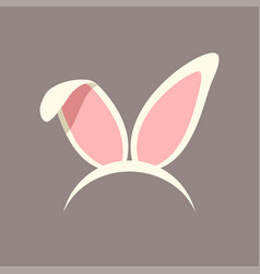 Bunny ears white color on brown back vector