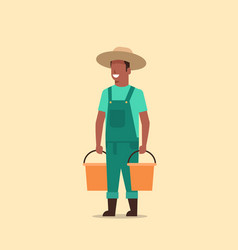 Male farmer holding water buckets african american vector