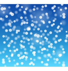 Snowflakes bokeh blue background vector image